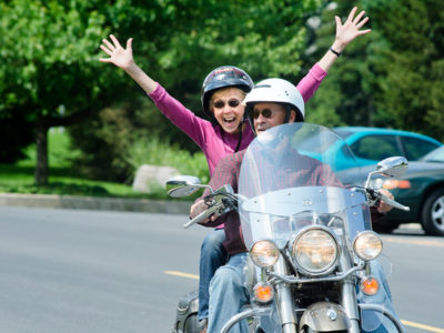 Couple riding motorycle